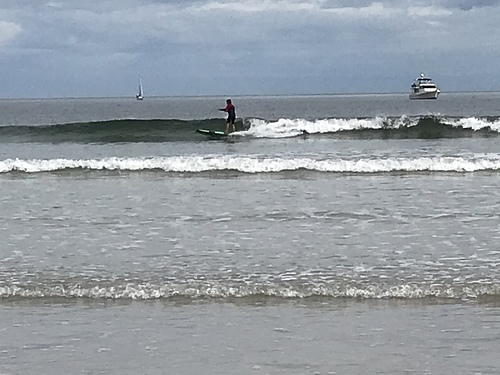 Surfing at North Haven Beach. Adelaide.