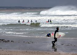 Surfer and wild swimmers, Aberdeen photo