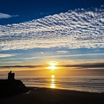 Sunset, high clouds, silhouetted Green Castle, Ballybunion