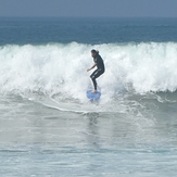 Surfer at jetty next to lifeguard tower 45, Gillis