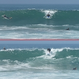 Surfers at jetty next to lifeguard tower 45, Gillis