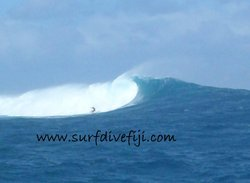 Big wave at Cloudbreak Surfing Fiji photo