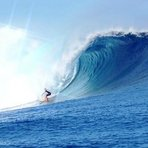 Big wave at Cloudbreak Surfing Fiji