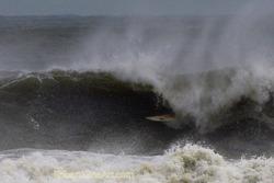 Tube ride - Hurricane Irene swell, St Augustine Beach Pier photo