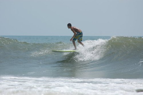 john q rips a right hander on trey whites longboard, North Myrtle/27th Avenue South