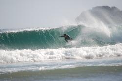 David agarrando el canto en Oriñon, Playa de Orinon photo
