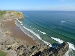 Tiny summer swell at Mewslade, Mewslade Bay photo
