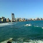 Surf en playa Poniente