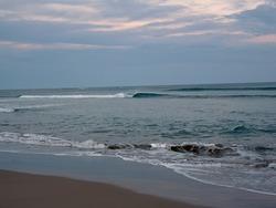 Tiny waves, Pouawa Beach photo